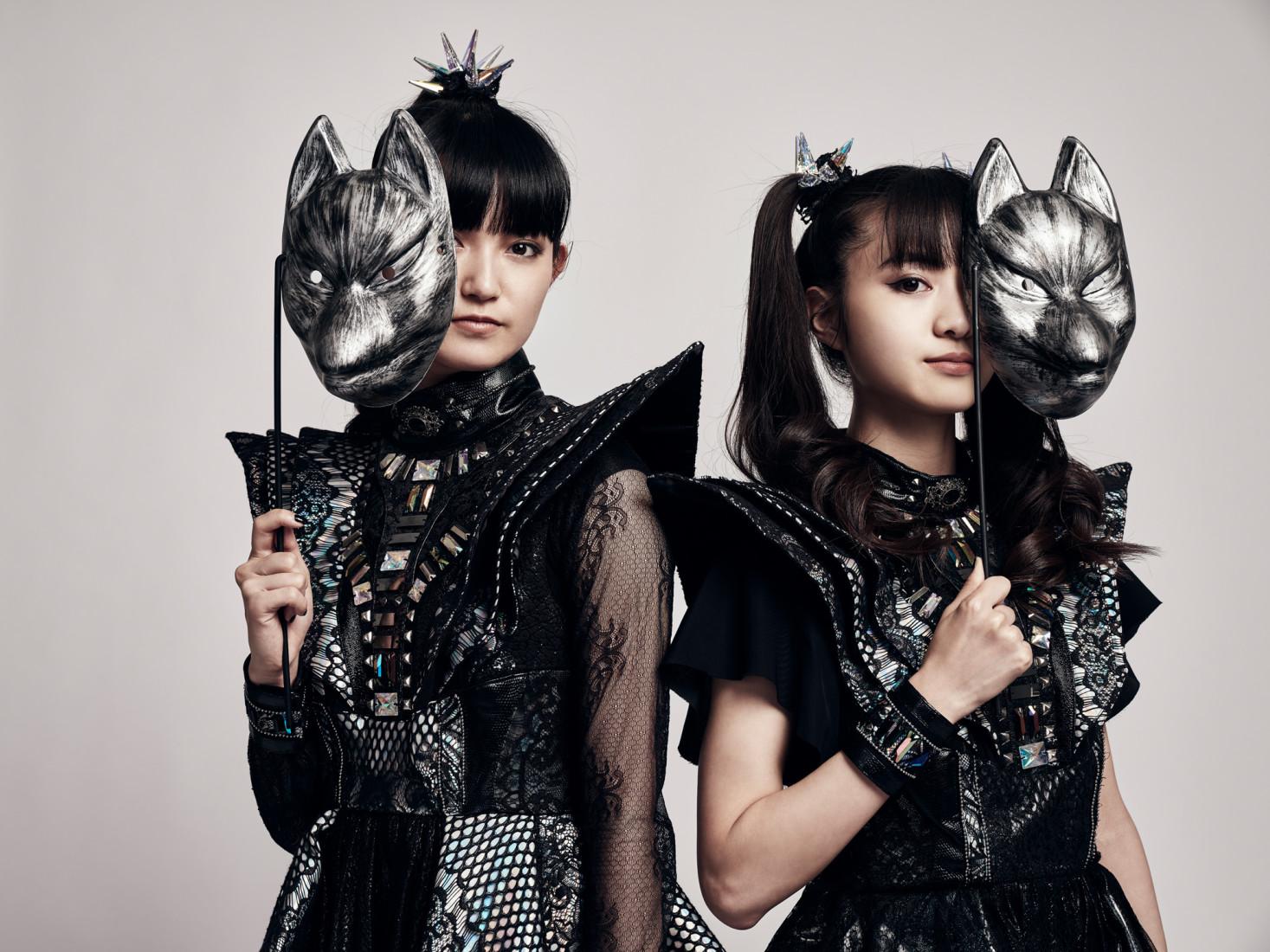 Japanese band Babymetal holding up new fox masks